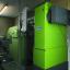Low-emission biomass heating with electrostatic precipitators